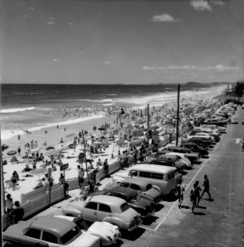 Crowded beach at Surfers Paradise ca. 1960  Image via The State Archives, Queensland